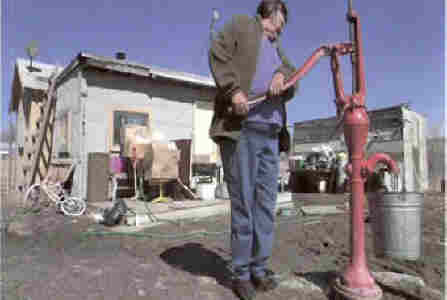 Poor-native-american-indians-well-water-pump-pumping1