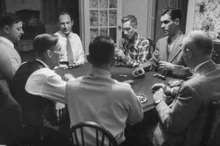 Peter-stackpole-men-sitting-around-a-table-in-a-private-home-playing-poker