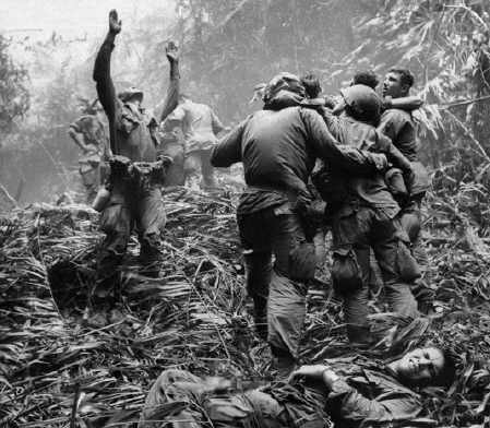 In-a-1968-Associated-Press-photo-from-Vietnam-by-Art-Greenspon-a-soldier-guides-an-unseen-medevac-helicopter-to-a-jungle-clearing-where-wounded-comrades-wait