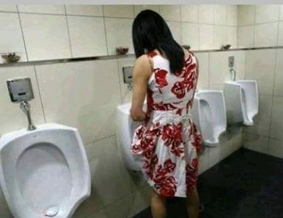 Bathroom-lady-at-urinal