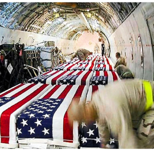 Coffins-of-u-s-soldiers-inside-a-cargo-plane-at-kuwait-international-airport-in-april-2004